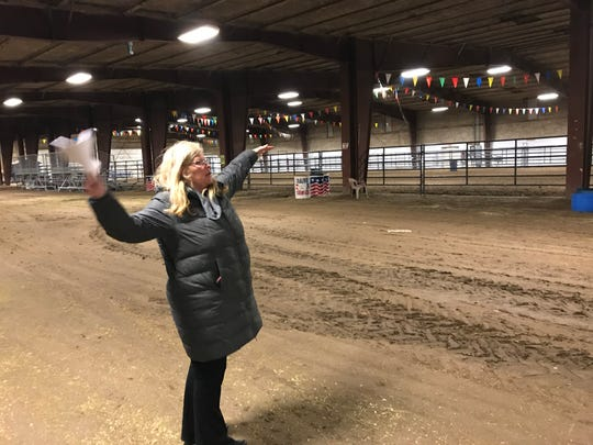 Susan Shannon, manager of Montana ExpoPark, explains the deficiencies of the Livestock Pavilion during a tour of ExpoPark grounds Thursday. Under a proposal for improvements, the Livestock Pavilion would be replaced and moved to the horse racing area for use as stalls.