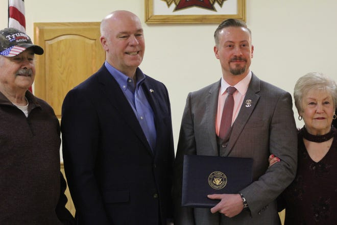 Montana Congressman Greg Gianforte (center left) stands next to Dr. Justin Madill (center right) during a ceremony Friday to award Madill the Montana Congressional Veteran Commendation. Shown with Gianforte and Madill and Justin Madill's parents, Cecil and Linda Madill.