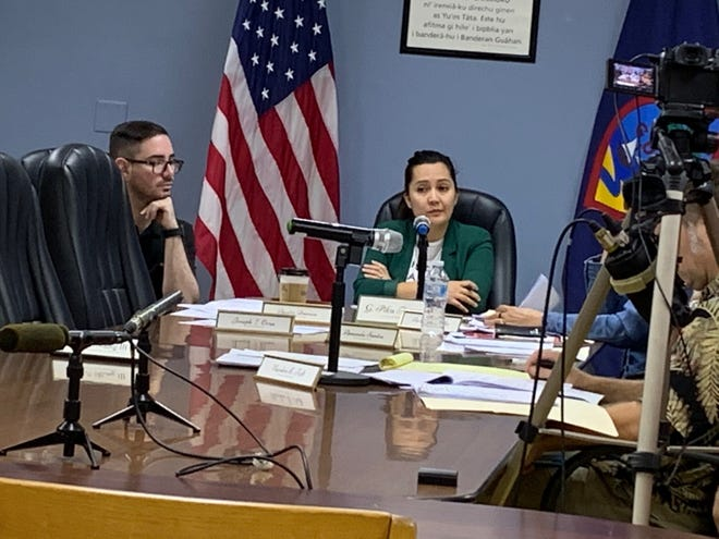 CHamoru Land Trust Commission member Austin Duenas, left, and Chairwoman Pika Fejeran, center, at the commission's monthly meeting, in this Feb. 20 file photo.