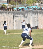 Action from the high school girls softball game between the Southern High School Dolphins and Academy of Our Lady of Guam Cougars. The Dolphins won 11-1 by mercy rule.