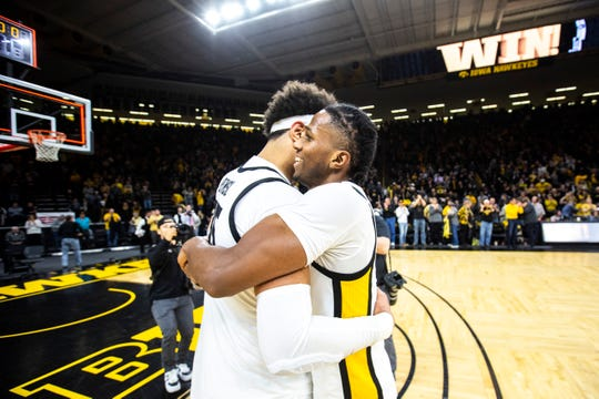 Iowa guard Bakari Evelyn, right, celebrates with teammate Cordell Pemsl after a NCAA Big Ten Conference men's basketball game against Ohio State, Thursday, Feb. 20, 2020, at Carver-Hawkeye Arena in Iowa City, Iowa.