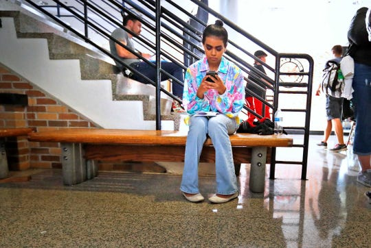 """Megan Suri, who plays the character Bindu, takes a moment to herself between scenes on the set of """"The MisEducation of Bindu"""" on July 17, 2018, at the old Broad Ripple High School."""