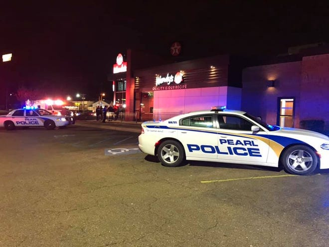 Police and paramedics respond to Wendy's restaurant on Pearson Road in Pearl after a worker is fatally stabbed Thursday night.