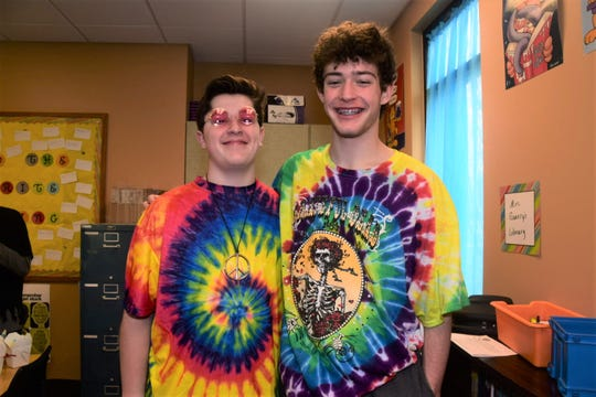 Cooper Crook, 14, and Jonathan Shaver, 14, dressed in their best hippie garb for hippie day at Episcopal School of Knoxville, Thursday, Feb. 13, 2020.