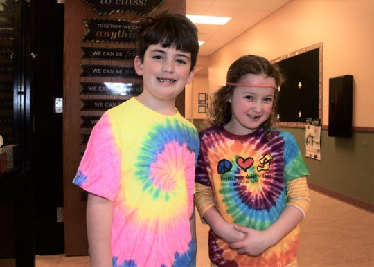 Hankins Balest, 7, and Meadow Copeland, 7, said they love their tie-dye t-shirts on hippie day at Episcopal School of Knoxville, Thursday, Feb. 13.