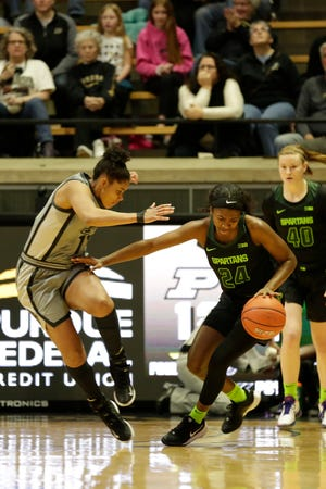 Michigan State guard Nia Clouden (24) dribbles against Purdue guard Dominique Oden (11) during the first quarter of a NCAA women's basketball game, Thursday, Feb. 20, 2020 at Mackey Arena in West Lafayette.