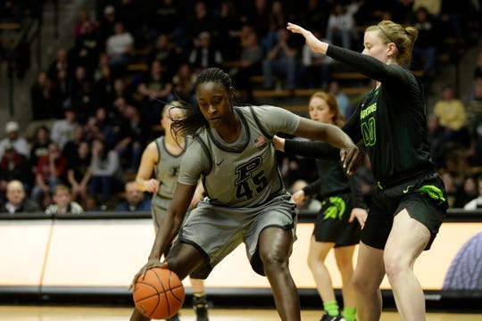 Purdue center Fatou Diagne (45) dribbles against Michigan State guard Julia Ayrault (40) during the second quarter of a NCAA women's basketball game, Thursday, Feb. 20, 2020 at Mackey Arena in West Lafayette.