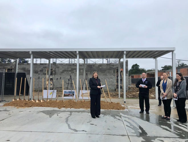 Jennifer Gardner (left), chief administrative officer of the Lafayette Parish School System, addresses L.J. Alleman Fine Arts Academy Principal Eric Luquette and fellow administrators, faculty and staff at a groundbreaking ceremony for the school's new classroom wing Wednesday, Feb. 19, 2020. The new 36,600-square foot building will replace 26 portable classrooms when it opens next school year.