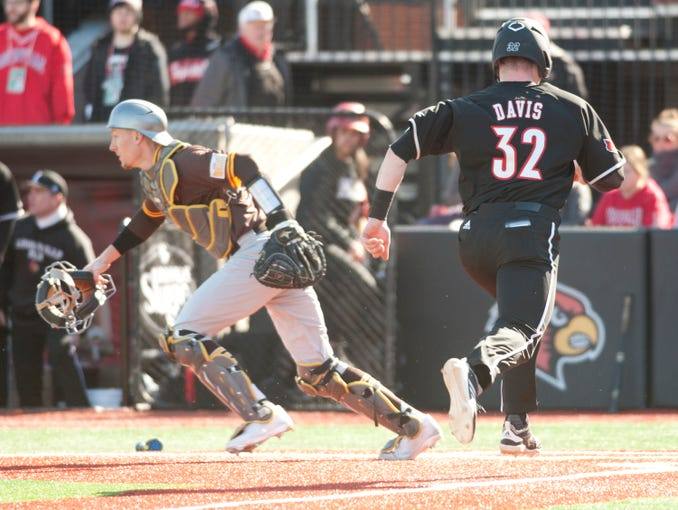 In the bottom of th second inning, University of Louisville's Justin Lavey flies out to Valparaiso University right fielder Riley Dent but misthrows to the infield allowing University of Louisville's Levi Usher to advance to 2nd and University of Louisville's Henry Davis to score. Feb. 21,  2020