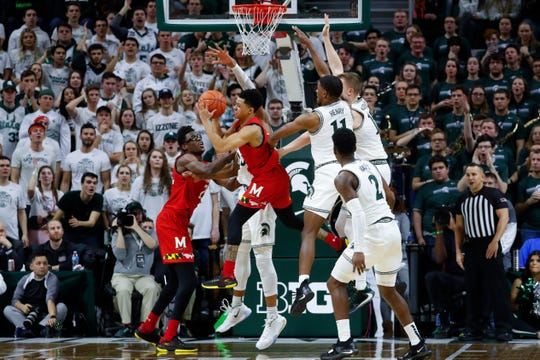 Anthony Cowan, center, and Jalen Smith, left, led Maryland past Michigan State, 67-60, two weeks ago at Breslin Center.