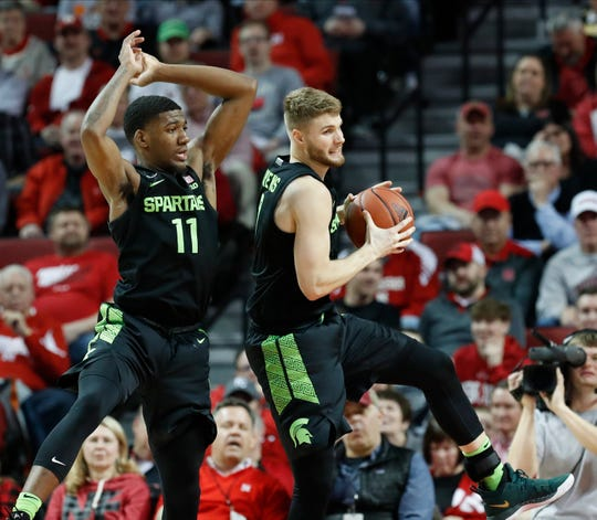 Michigan State forward Kyle Ahrens (0) grabs the rebound with forward Aaron Henry (11) in the second half against Nebraska on Thursday night in Lincoln. Ahrens finished with 14 points and seven rebounds in 22 minutes.