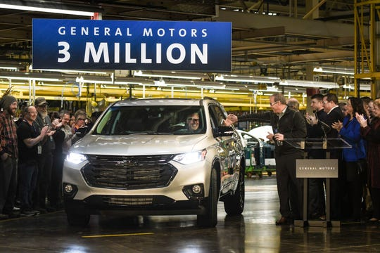 General Motors Manufacturing Executive Director Mike Trevorrow, right, high fives GM employee Darrell Kransz, as he drives the 3-millionth vehicle produced at the Lansing Delta Township Assembly plant off the line, Friday, Feb. 21, 2020.