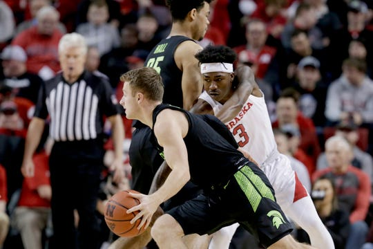 Michigan State's Jack Hoiberg (10) drives around Nebraska's Cam Mack (3) during the first half of an NCAA college basketball game in Lincoln, Neb., Thursday, Feb. 20, 2020. (AP Photo/Nati Harnik)