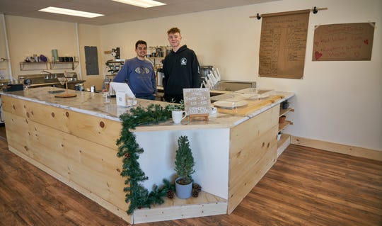 Keaton Sanjur (left) recently opened Keat's Coffee at 617 Claremont Ave., a short walk from Ashland University's campus. His friend, Ben Hahn (left) was hanging out at the shop.