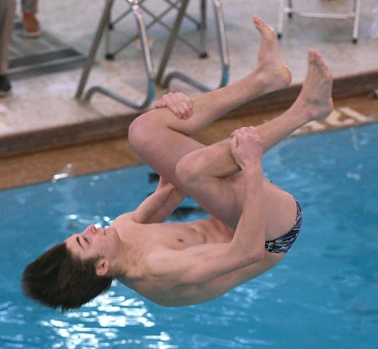 Lexinton's Bobby Keller during Wednesday's 1 meter diving competition