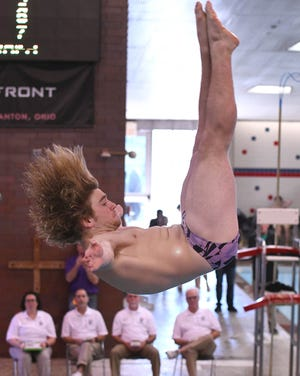 Lexington's Max Roth competes at the 2020 OHSAA Division II State Swimming and Diving Tournament. Roth is one of five local divers to advance to next week's state tournament.