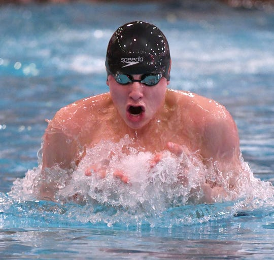 Ashland sophomore Rylan McDaniel competes in the breaststroke during the 200 medley relay at the Division II state swim meet
