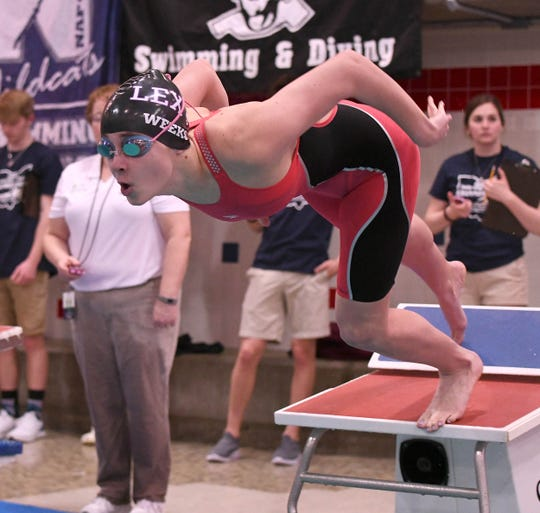 Lexington's Lily Weeks takes off in her heat of the 200 IM at the state swim meet