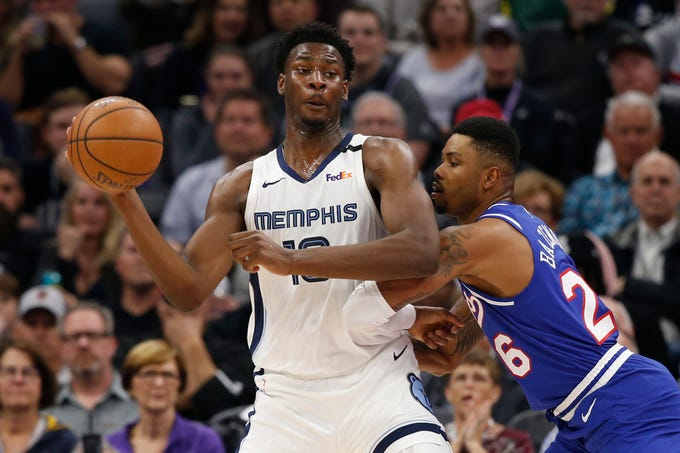 Memphis Grizzlies forward Jaren Jackson Jr.,left, looks to pass against Sacramento Kings guard Kent Bazemore, right, during the first quarter of an NBA basketball game Thursday, Feb. 20, 2020, in Sacramento, Calif. (AP Photo/Rich Pedroncelli)