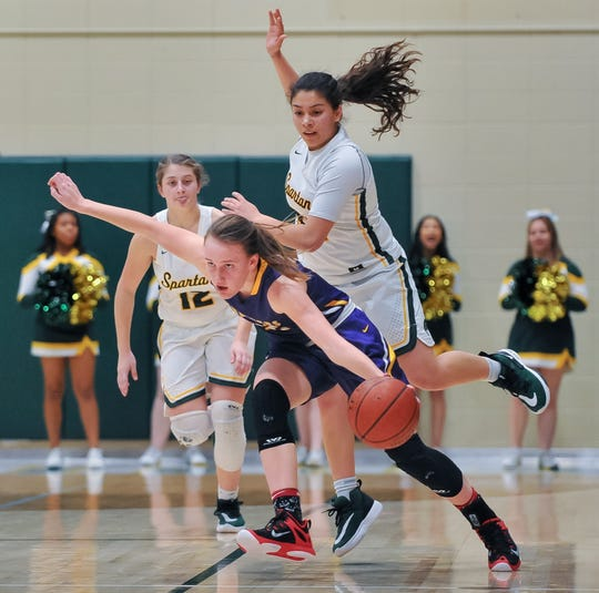 Racine Lutheran guard Caroline Strande draws a foul on Martin Luther guard Vanessa Solano during a regular-season game on Feb. 20. Strande is a repeat first-team all-state honoree.