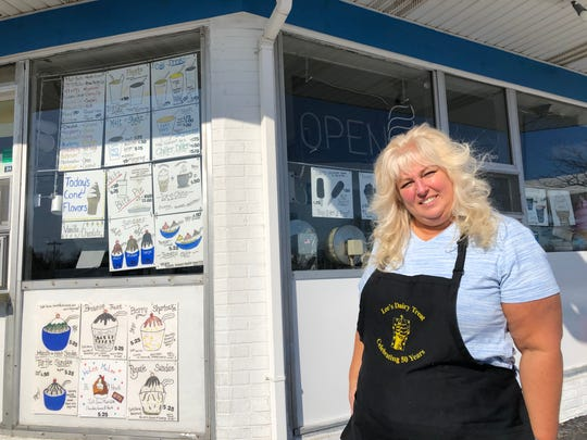 Danette Bugs-Janik, owner of Lee's Dairy Treat, stands in front of her shop.