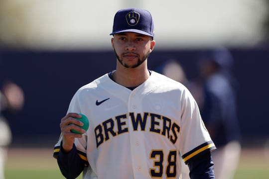 Relief pitcher Devin Williams made 13 appearances over two separate stints for Milwaukee last season, but he is seeking to make his first opening-day roster with the Brewers.