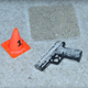 Police recovered the 23-year-old man's loaded pistol from the scene.