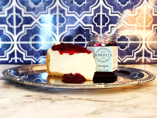 Wine jelly can go with a lot of foods, says the creator of Wandering Wine Glass. This  is Sangria jelly on top of a slice of cheesecake.