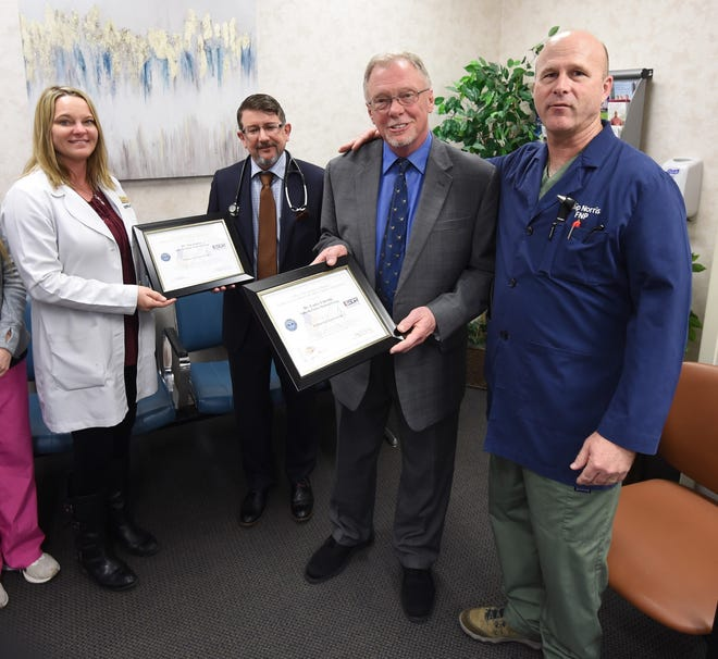 "Nurse practitioner Julie Norris (far left) and nurse practitioner Wilton ""Chip"" Norris (far right) present Dr. Timothy Paden (second from left) and Dr. Lance Lincoln (second from right) with Patriot Awards on Thursday."