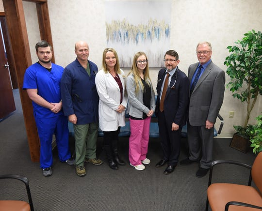 """The Lincoln Paden Medical Group employs four people serving in the National Guard. Those employees include (from left) nurse Michael Miller, nurse practitioner Wilton """"Chip"""" Norris, nurse practitioner Julie Norris and receptionist Ashlin Schlafke. Also seen are their employers, (from far right) Dr. Lance Lincoln and Dr. Timothy Paden."""