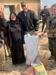 Louisiana Congressman Ralph Abraham, R-alto, visits with civilians in northeastern Syria.