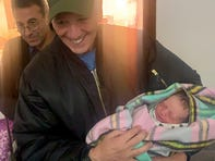Louisiana Congressman Ralph Abraham, R-Alto, holds a baby at a hospital on the front lines of fighting in northeastern Syria.