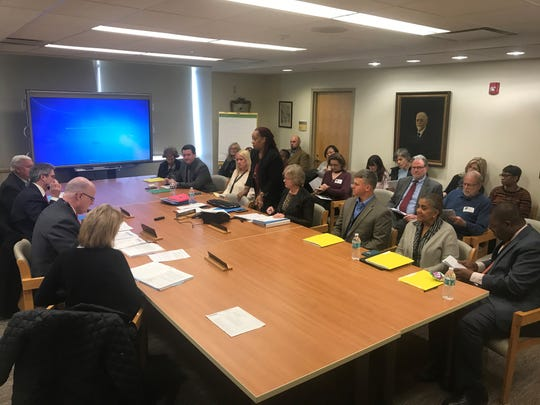 Greystone Park Psychiatric Hospital CEO Tomika Carter, standing, conducts a meeting of the Grystone board of trustees, with members of the public sitting in back. Feb. 20, 2020.