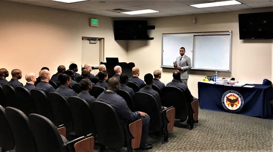 Reed talking to recruits at a police academy ceremony Friday.
