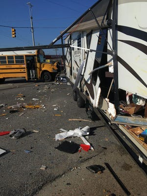 Three vehicles including a school bus, with two adults and one child on board, and an RV collided at the intersection of Woodley Road and East South Boulevard.