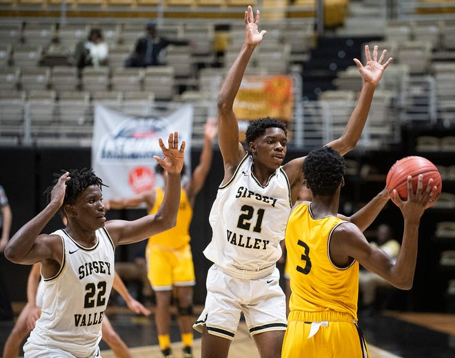 Sipsey Valley's Jamyas Davis (22) and  Martavious Russell (21) double team Williamson's Clifton Granderson (3) in AHSAA regional action in Montgomery, Ala., on Thursday February 20, 2020.