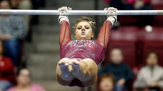 Alabama's Kylie Dixon competes during an NCAA Women's gymnastics meet Friday, Feb. 14, 2020, in Tuscaloosa, Ala. (AP Photo/Butch Dill)