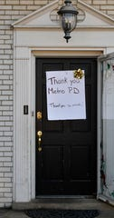 """A neighbor across the street from a house in the 300 block of Monaco Drive that was padlocked Thursday and deemed """"public nuisance"""" in Hermitage, Tenn put up a sign thanking Metro Police on Friday, Feb. 21, 2020."""