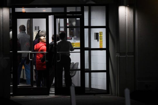 People enter Riverbend Maximum Security Institution before the execution of death row inmate Nicholas Sutton.
