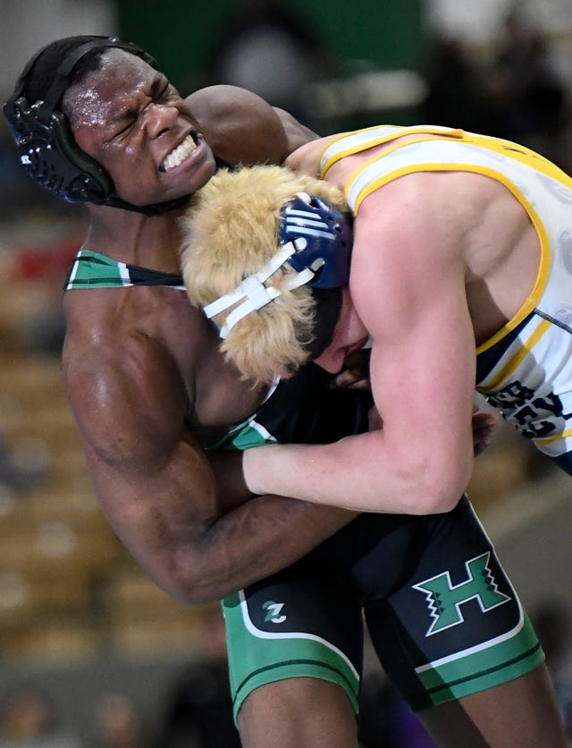 Hillwood's Sikura Ekunsumi grimaces as he wrestles Walker Valley's Heath Tanksley during the TSSAA individual wrestling state championships at Williamson Co. Ag Center Thursday, Feb. 20, 2020 in Franklin, Tenn.