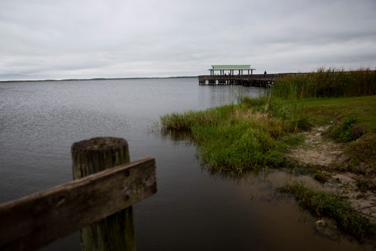 Visitors look out over the water from the pier at Lake Trafford in Immokalee on Friday, February 21, 2020.