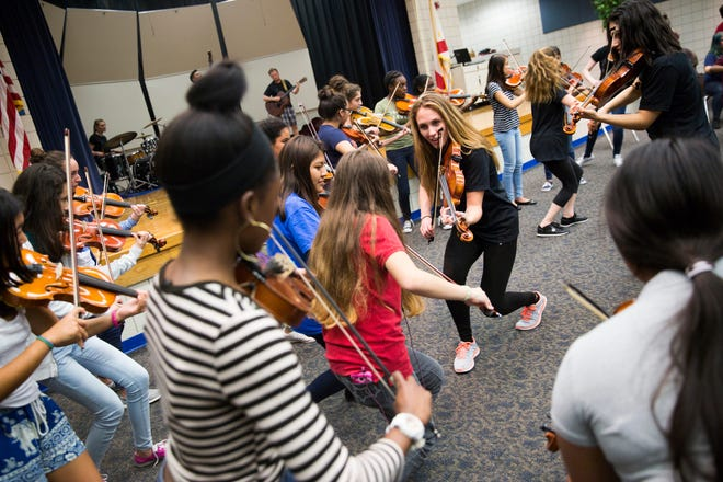 The Music Foundation of Greater Naples not only conducts competitions, but offers master classes for public school students, such as this one in 2017 with Barrage 8.