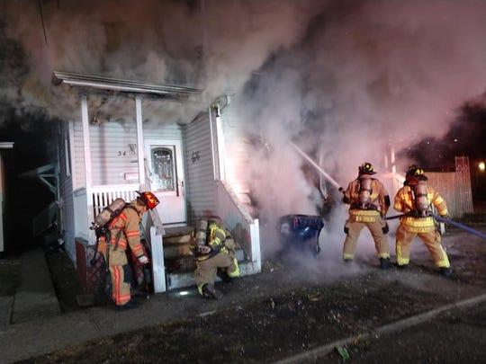 Newark firefighters battled a fire on Chestnut Street in Newark on Thursday, Feb. 20, 2020.