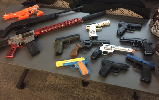 This array of real and toy guns was used to drive home just how hard it can be to distinguish real from toy firearms or BB guns. Several youths and parents were fooled.