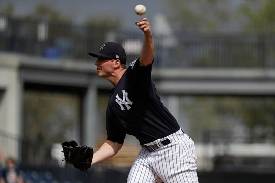 New York Yankees' Zack Britton delivers a pitch during a spring training baseball workout Thursday, Feb. 20, 2020, in Tampa, Fla. (AP Photo/Frank Franklin II)