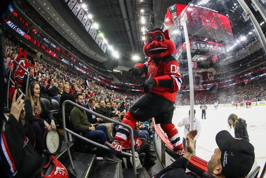 Feb 20, 2020; Newark, New Jersey, USA; NJ Devil leads the fans in a cheer during the first period of the game between the New Jersey Devils and the San Jose Sharks at Prudential Center.