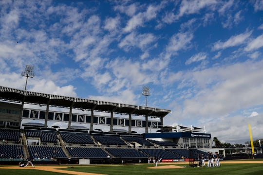New York Yankees staff watch Jonathan Loaisiga delivers a pitch during live batting practice at a spring training baseball workout Thursday, Feb. 20, 2020, in Tampa, Fla.