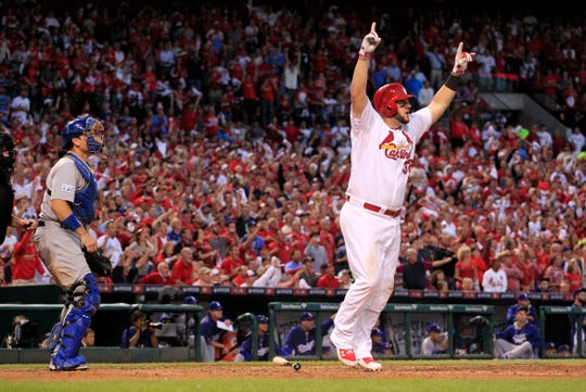 St. Louis Cardinals first baseman Matt Adams celebrates after hitting a three-run home in the seventh inning of Game 4 of baseball's NL Division Series against the Los Angeles Dodgers, Tuesday, Oct. 7, 2014, in St. Louis.