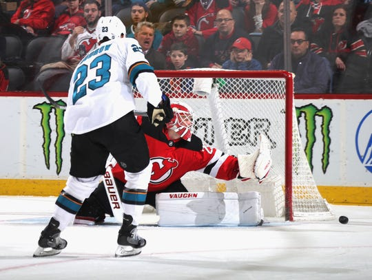 Mackenzie Blackwood #29 of the New Jersey Devils makes the first period save on Barclay Goodrow #23 of the San Jose Sharks at the Prudential Center on February 20, 2020 in Newark, New Jersey.