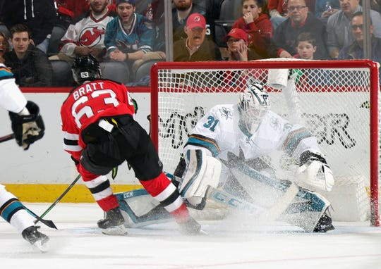 Jesper Bratt #63 of the New Jersey Devils scores on Martin Jones #31 of the San Jose Sharks at 16:15 of the second period at the Prudential Center on February 20, 2020 in Newark, New Jersey.